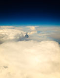 White cloudy sky. View from airplane flying in clouds. Stock Images