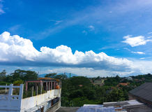White cloudy sky view from rooftop`s house photo taken in Jakarta Indonesia. Java Stock Photo