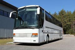 White Coach Bus Parked Stock Photo
