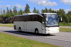 White Coach Bus Travel along Freeway at Summer Stock Photo