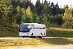 White Coach Bus Travel in Autumn Stock Photo