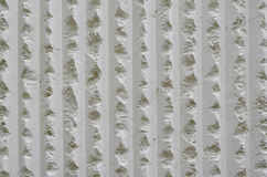 White coarse cement wall background. White coarse cement wall texture stock photo