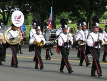 White Coated Marching Band. Photo of white coated marching band on constitution avenue in washington dc on 5/29/17 on memorial day. This was one many groups Stock Photo
