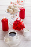 White coconut candies with cup of coffee Stock Photos