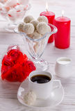 White coconut candies with cup of coffee Stock Image