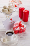 White coconut candies with cup of coffee Royalty Free Stock Photos