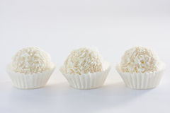 White coconut truffles. White sweet coconut truffles, close up Stock Images