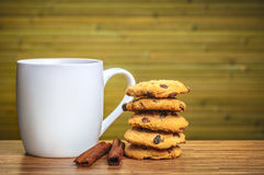 White cofee cup with batch of cookies Royalty Free Stock Images