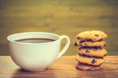 White cofee cup with batch of cookies Royalty Free Stock Photo