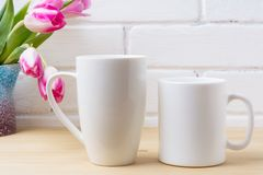 White coffee and cappuccino mug mockup with magenta tulip Royalty Free Stock Images