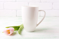 White coffee cappuccino mug mockup with  pink tulip Royalty Free Stock Photos