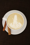 White coffee with cinnamon. Latte. Drawings on coffee. Delicious breakfast Stock Photography