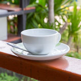 White coffee cup on the banister Royalty Free Stock Image