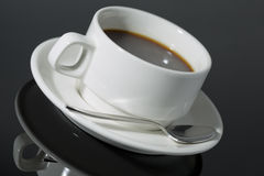 White coffee cup on a black background with reflection shadow Stock Photos