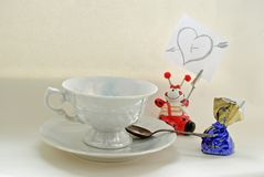 White coffee cup, candy and note with heart Royalty Free Stock Images
