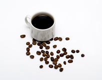 White coffee cup and coffee beans Stock Image