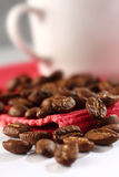 White coffee cup with coffee beans Royalty Free Stock Image