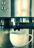 White coffee cup and coffee maker ,with a retro effect Royalty Free Stock Image