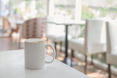 White coffee cup in coffee shop Royalty Free Stock Photography