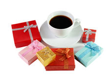 White coffee cup and colorful gift boxes isolated on white Stock Photos