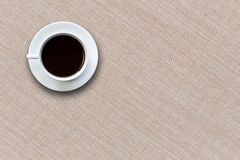 White coffee cup on fabric background top view Royalty Free Stock Photography