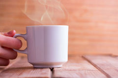 White Coffee cup. In hand. mock up Stock Image