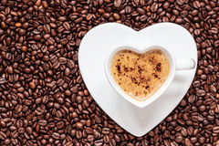 White coffee cup heart shaped with cappucino Stock Photography