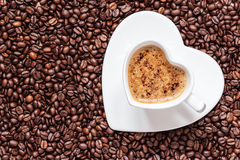 White coffee cup heart shaped with cappucino Royalty Free Stock Images