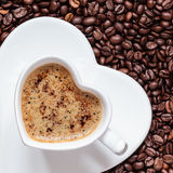 White coffee cup heart shaped with cappucino Royalty Free Stock Photos