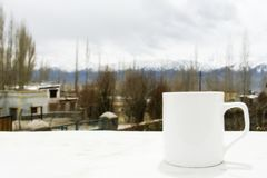 White coffee cup with Himalaya mountain view at Ladakh, India.  stock image