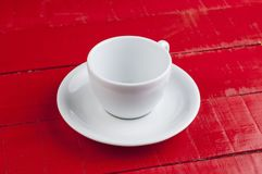White coffee cup isolated on a red background. Cappuccino beverage aroma energy drink morning tasty breakfast hot latte espresso black cafe mug caffeine object royalty free stock image