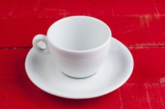 White coffee cup isolated on a red background. Cappuccino beverage aroma energy drink morning tasty breakfast hot latte espresso black cafe mug caffeine object stock photography