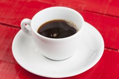 White coffee cup with isolated on a red background. White coffee cup with  isolated on a red background cappuccino beverage concept aroma advertising energy milk stock photography