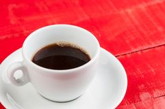 White coffee cup with isolated on a red background. White coffee cup with  isolated on a red background cappuccino beverage concept aroma advertising energy milk royalty free stock photos