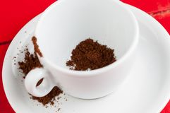 White coffee cup with metal spoon isolated on a red background. Beverage aroma morning breakfast cappuccino hot foam cafe mug energy milk drink vintage latte stock images