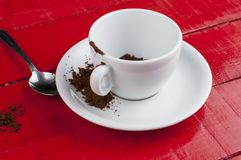 White coffee cup with metal spoon isolated on a red background. Beverage aroma morning breakfast cappuccino hot foam cafe mug energy milk drink vintage latte stock photo