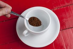White coffee cup with metal spoon isolated on a red background. Beverage aroma morning breakfast cappuccino hot foam cafe mug energy milk drink vintage latte stock photos