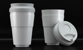 White coffee cup mockups on dark background Royalty Free Stock Images