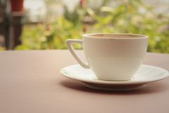 White coffee cup with saucer at the coffee shop Stock Photo