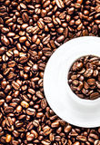 White Coffee Cup with saucer full of Roasted Coffee Beans on cof Stock Photo