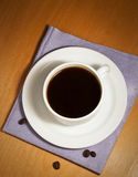 White coffee cup and saucer on a napkin Stock Photo