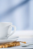 White coffee cup and spoon Royalty Free Stock Photo
