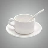 White coffee cup with a spoon on the saucer Stock Photos