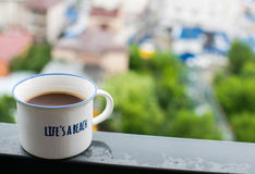 White coffee cup on steel beam Royalty Free Stock Images