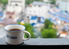 White coffee cup on steel beam Royalty Free Stock Photo