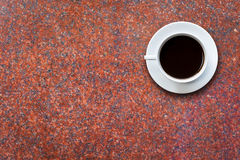 White coffee cup on stone table background top view Royalty Free Stock Image