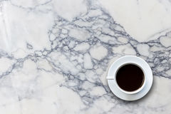 White coffee cup on stone table background top view Royalty Free Stock Photo