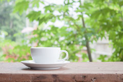 White coffee cup on tabletop Royalty Free Stock Image