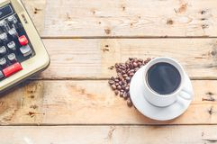 White coffee cup on wood table background Stock Images