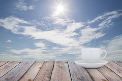 White Coffee cup on the wood table with scenery  background. Stock Image